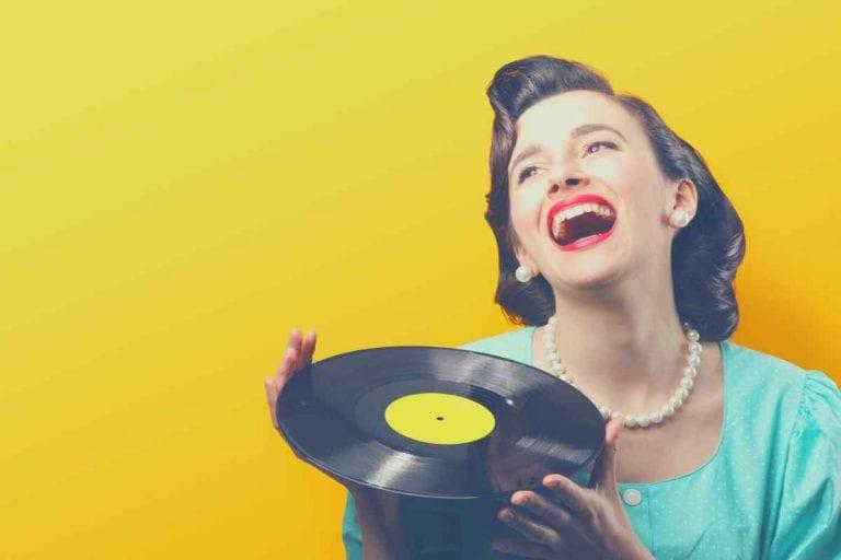 lady holding old vinyl record