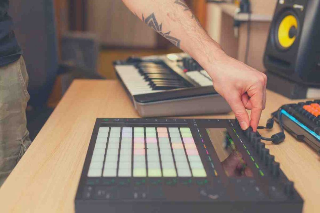 bedroom studio producer making beats