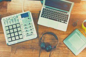 bedroom music studio laptop and midi controller