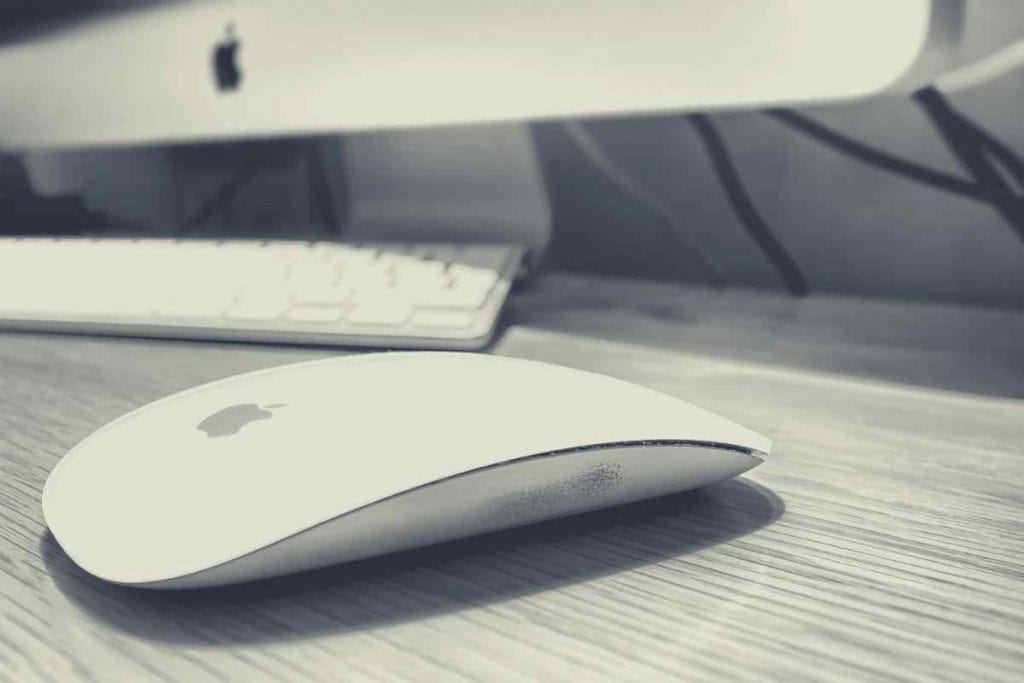 Imac and mac mouse on a desk