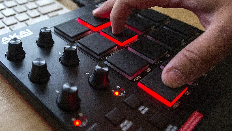 Man playing AKAI MPD218 MIDI Pad Controller