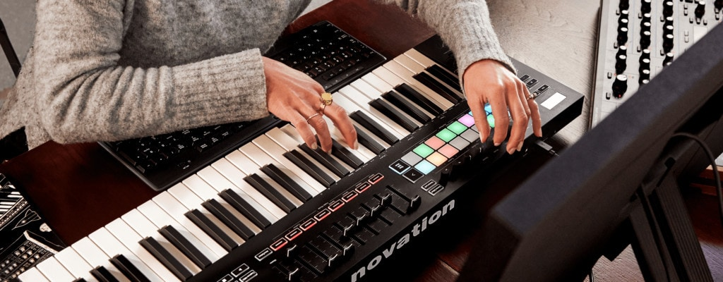 Person playing Novation MIDI Keyboard