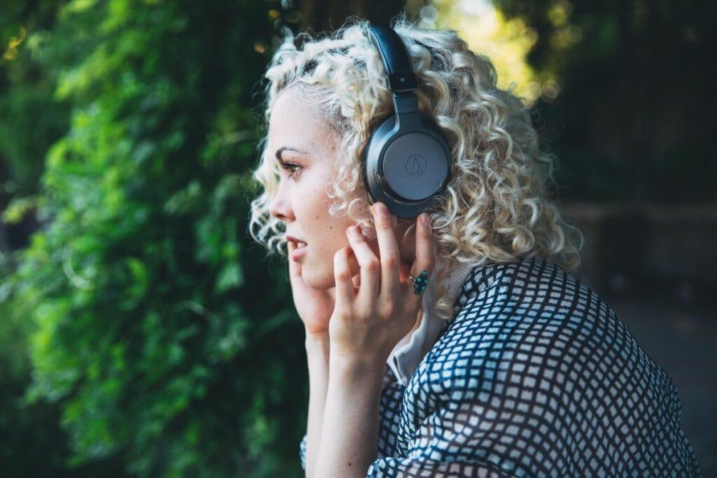 Woman wearing audio technica headphones